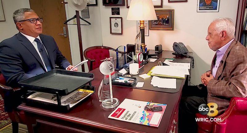 Wilder at Desk during Interview